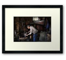 Blacksmith - Tinkering with metal  Framed Print