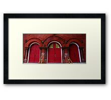 3 Doors, 4 Faces Framed Print