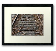 Between The Rails Framed Print