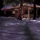 Cabin in the snowy woods during the holidays by Cathleen Knutson