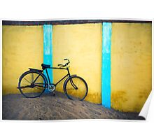 Bicycle against wall Poster