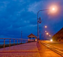 Kirra waterfront on stormy evening by flexigav