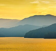 Early Morning Boat Ride on a Lake of Gold by Greg Booher