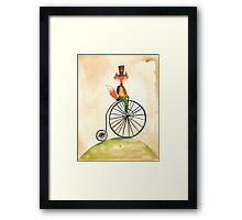foxy on his penny farthing Framed Print