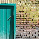 Green door and brick wall by richard  webb
