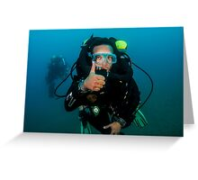 scuba diver demonstrates the sign language for divers. Greeting Card