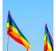 Gay rainbow flag with a blue sky background  Photographic Print