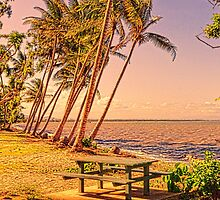 Coconut palms on beach with picnic table by hereswendy