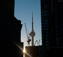 Sun Setting On CN Tower Framed By Towers by Gary Chapple