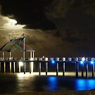 Pier at night by footsiephoto