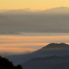 Dawning Sunbeams Fall Across Valley Fog by Jean Gregory  Evans