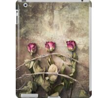 three dried roses and barbed wire iPad Case/Skin