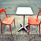 two orange chairs by Tania Palermo