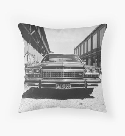 The American. Throw Pillow