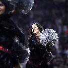 Cheerleader At ball Game  by loyaltyphoto