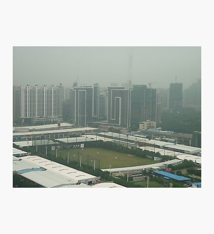 Soccer pitch surrounded by smog Photographic Print