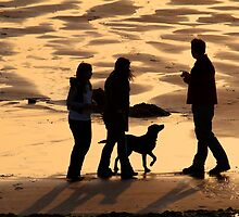 Walking The Dog on North Shore, Whitehaven, Cumbria by Jan Fialkowski