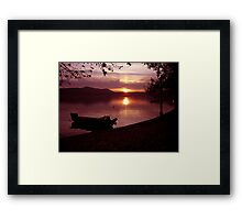 Boat into a pink atmosphiere Framed Print