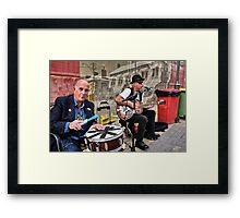 Market Buskers Framed Print