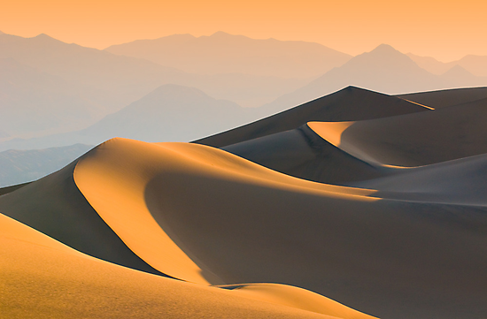 Sand dunes over sunrise sky in Death valley, California by javarman