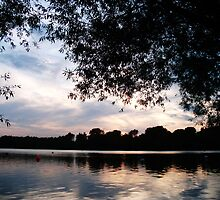 Bury Lake as the sun sets reflecting the trees upon the water by Luketxx