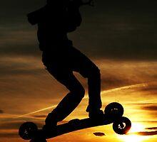 Kiteboarder flying through the Sunset. by Samuel  Dodd