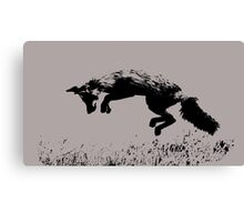 pouncing fox playing in the meadow Canvas Print