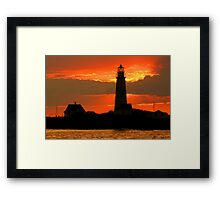 Boston Light at sunset Framed Print