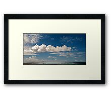 Clouds, Blue sky and surf Framed Print