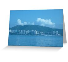 Clouds peeking at city from over a mountain Greeting Card