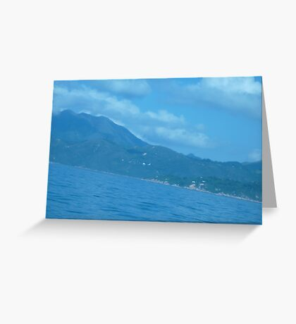 Puffy clouds floating over Island Greeting Card