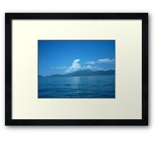 Cloud horse drifting over a island. Framed Print