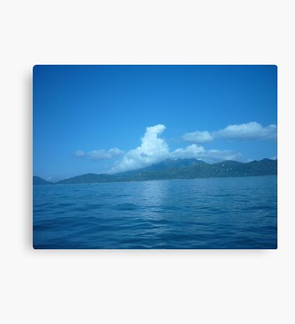 Cloud horse drifting over a island. Canvas Print