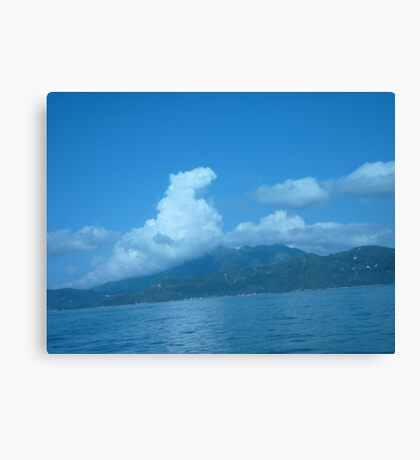 Dragon floating over a Island Canvas Print