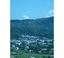 Mountains surrounding a little village Photographic Print