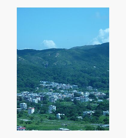 Mountains surrounding a little village Photographic Print