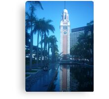 Shimmering reflection of magnificent clock tower Canvas Print
