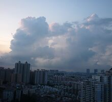 Morning clouds towering over the city by Joseph Green