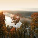 Sunrise, fog, river in autumn  by Antanas