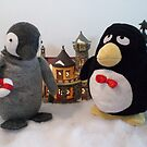 Penguins in a small village by Rie Kaminsky