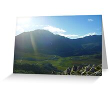 Hiking over the crest of a mountain, the sun picked out this beautiful verdant valley Greeting Card