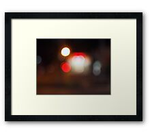 Abstract blurred image of circular lights on the night road Framed Print
