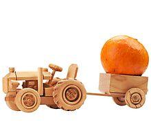 Toy tractor with orange pumpkin. Photographic Print