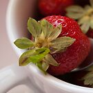 Macro and vibrant colored strawberry by Patrizia  Corriero