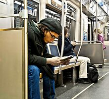Reader on the train... by James Watkins