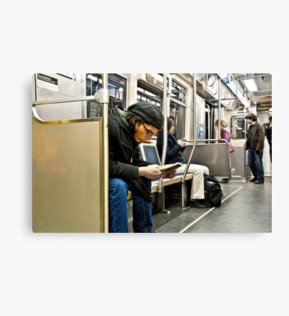 Reader on the train... Canvas Print