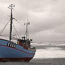Boat on the beach by Britta Döll