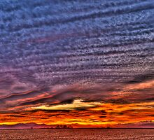 Ripples of  Sunset by Gregory J Summers