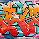 Colorful Abstract Graffiti detail on the textured wall by yurix