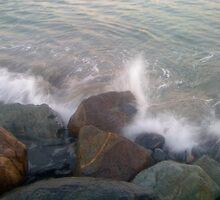 crashing wave on the rocks by karlbrobicsek